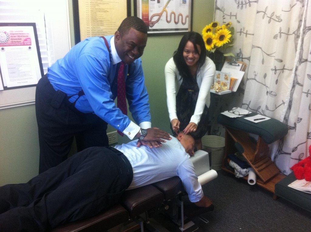 Dr Han getting a chiropractic adjustment